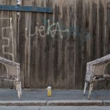 Two chairs and a beer