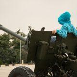 Child relaxing on war machine